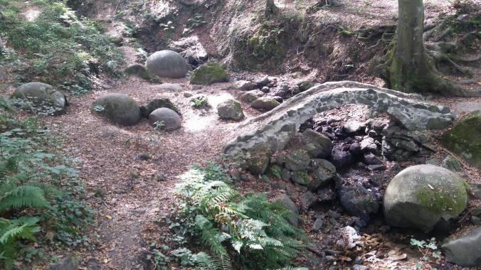 creek-with-whole-and-broken-stone-spheres-photo-by-shawn-rateau