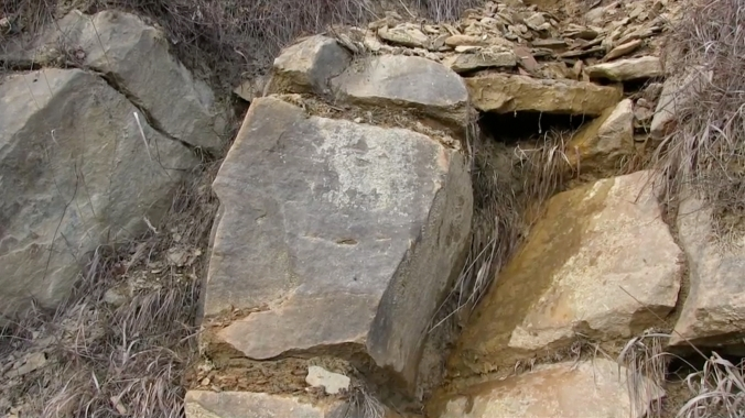 Structurally sound inclined hard baked claystone layers on Osijela Hill, alternating with soft earthquake-mitigating clay layers, March 3, 2015 re-edited video copy